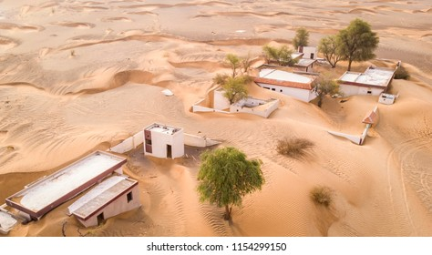 aerial view of amandoned village in a desert near dubai
