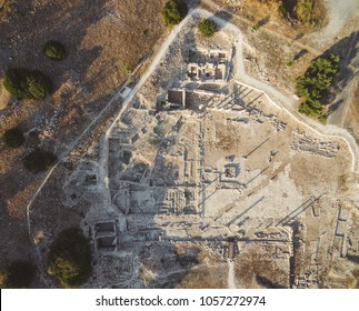 Aerial view of Amathounta ruins and columns at ancient greek roman archaeological site at Agios Tychonas, Limassol, Cyprus. Amathus royal city dig remains from above by Mediterranean sea island.
