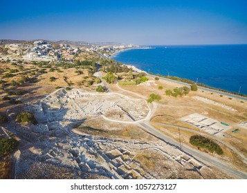 Aerial view of Amathounta ruins and columns at ancient greek roman archaeological site at Agios Tychonas, Limassol, Cyprus. Amathus royal city remains and coastal road in Mediterranean sea island.