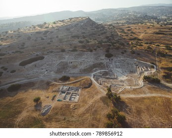 Aerial view of Amathounta ruins and columns at ancient greek roman archaeological site dig at Agios Tychonas, Limassol, Cyprus. Amathus royal city excavation remains from above by Mediterranean sea.