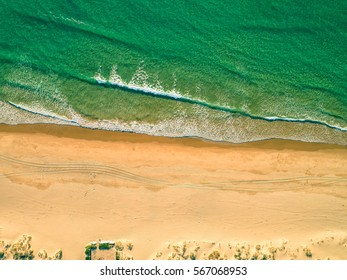 Aerial View Amazing Seascape with Small Waves on Sandy Beach, Portugal