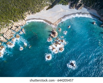 Aerial view of the amazing turquoise beach. Emerald Coast in Sardinia Island, is one of the most beautiful and famous coasts in the world
