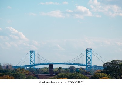 aerial view of Ambassador Bridge connecting to Canada from distance during daytime, detroit midtown USA