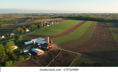Aerial view of american countryside landscape. Farm, red barn, cows. Rural scenery, farmland. Sunny morning, spring summer season