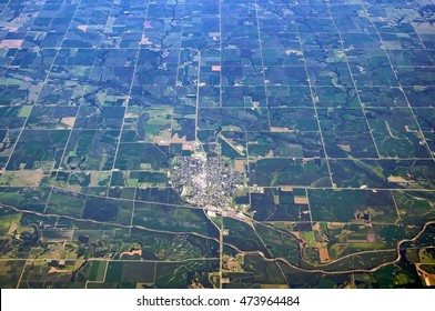 Aerial view of American Midwest Falls city Nebraska United States of America rural scenery with generic crops river airport roads detail exterior satellite landmark