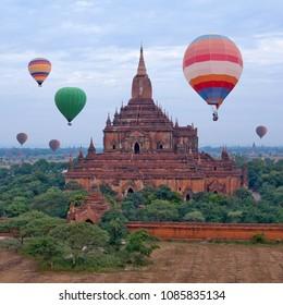 Aerial view of ancient Sulamani pagoda and hot air balloons flying over Bagan, Mandalay Division, Myanmar