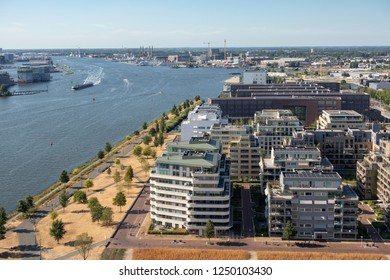 Aerial view apartment buildings Amsterdam near harbor and North Sea canal