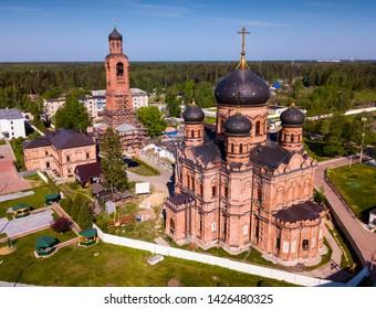 Aerial view of architectural complex of Russian Orthodox Guslitsky Transfiguration Monastery in town of Kurovskoye, Orekhovo-Zuyevo District