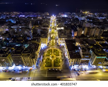Aerial view of Aristotelous Square and the northern Greek city Thessaloniki at night. Image taken with action drone camera causing distortion and blur.