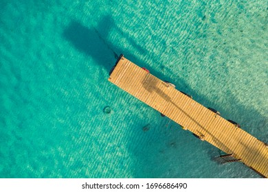 Aerial view around Playa Grandi - Curaçao - Caribbean Sea with turquoise water, cliff, beach and beautiful coral reef