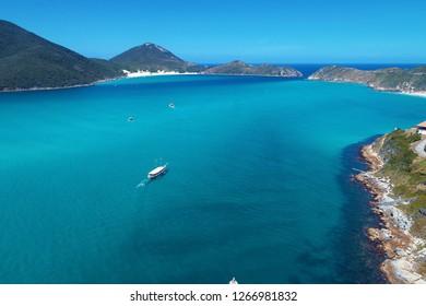 Aerial view of Arraial do Cabo beach, Rio de Janeiro, Brazil. Brazillian Caribbean. Fantastic landscape. Great beach scene with blue sea. Travel destination, Vacation travel, Relaxation. Boat sailing.