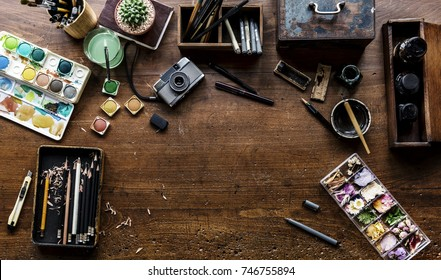 Aerial view of artistic equipments painting tools on wooden table