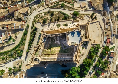 Aerial view of Atalaya castle over Villena Spain. The fortress has concentric plan, with a rectangular barbican forming space in front of the keep.  The external wall has chemin-de-ronde or wall-walk