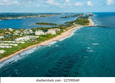 aerial view of atlantic ocean shoreline, intracoastal inlet and pier at boynton beach florida, with palm beach in the distance