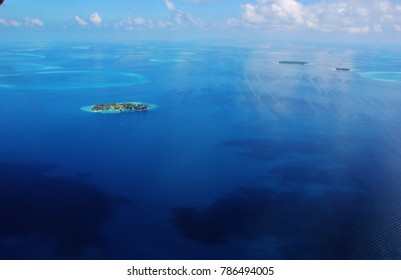 Aerial view of atolls in the Maldives. Aarah island and Bandos islands, Male Nord Atoll.