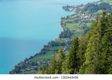 Aerial view of Attersee lake in Austria, with a clear sight of the coast line road, on a Summer holiday trip.