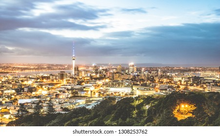 Aerial view of Auckland skyline from Mount Eden after sunset during blue hour - New Zealand modern city with majestic nightscape panorama -  Enhanced filter on night lights