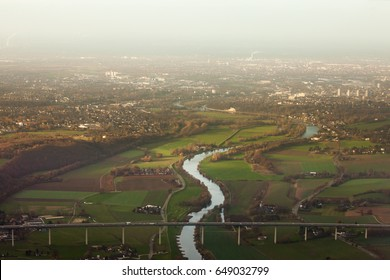 Aerial view of autobahn bridge over Ruhr river at Essen-Kettwig with city of Muehlheim in background of industrial area of Ruhrgebiet, Germany, Europe