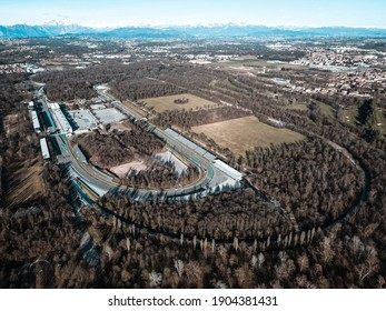 Aerial view of The Autodromo Nazionale of Monza, that is a race track located near the city of Monza, north of Milan, in Italy. Epic drone shot of the circuit in Monza.