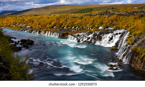 Aerial View of autumn foliage at Hraunfossar Waterfalls in Husafell, West Iceland