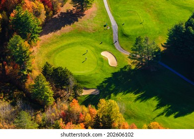 Aerial view in the autumn of golfers on the green at a golf course, Stowe, Vermont, USA