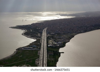 Aerial view of Avcilar district of Istanbul and Kucukcekmece lake in cloudy and dark weather. There is a ring road and metrobus road in the center