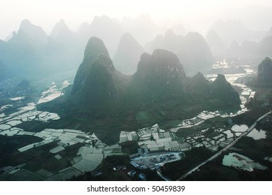 aerial view from the balloon: silhouettes of the mountain with the sunset, Yangshuo, China, Asia