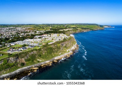 Aerial view of Ballycastle with steep cliffs. Atlantic coast, County Antrim, Northern Ireland, UK