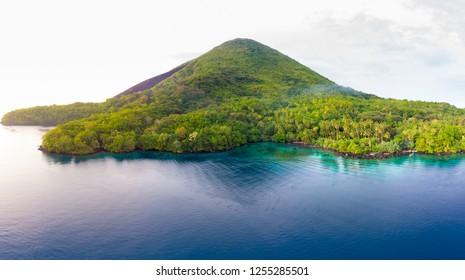 Aerial view Banda Islands Moluccas archipelago Indonesia, Pulau Gunung Api, lava flows, coral reef. Top travel tourist destination, best diving snorkeling.