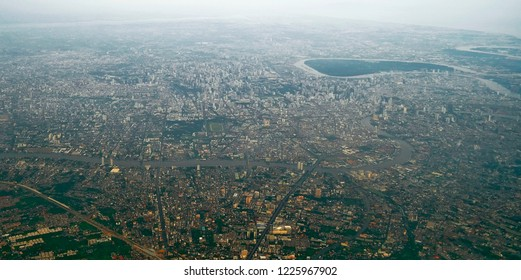 Aerial view of Bangkok with Bang Kachao from a plane about to land at Don Mueang Airport