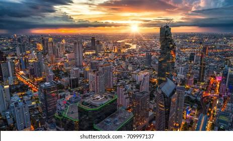 Aerial view of Bangkok buildings, Bangkok city downtown with sunset sky, Transaction beautiful road top view at night traffic