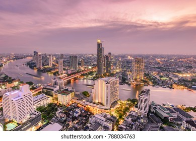 Aerial view of Bangkok city with Chao Phraya river during sunset