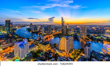 Aerial view of Bangkok City modern office buildings, condominium, hotel in Bangkok city downtown business and finance with Chao Phraya River during sunset sky, Bangkok, Thailand.