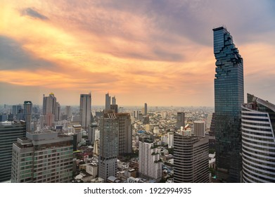 Aerial view of Bangkok city at twilight sunset in Thailand. cityscape of Modern buildings and urban architecture