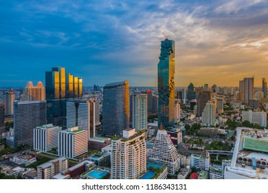 Aerial view of Bangkok Cityscape with modern office buildings, condominium in city downtown with sunset sky, Bangkok, Thailand.