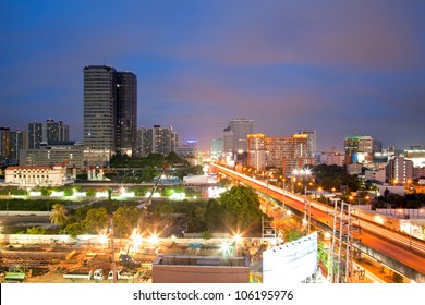Aerial view of Bangkok Highway and building at downtown area at dusk