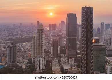 Aerial view of Bangkok modern office buildings at sunset sky, Thailand