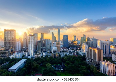 Aerial view of Bangkok modern office buildings, condominium in Bangkok city downtown with sunset sky ,Bangkok is the most populated city in Southeast Asia.