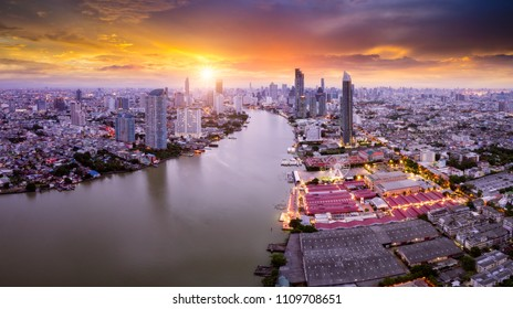 Aerial view of Bangkok skyline panorama and skyscraper in center of Bangkok city. Modern buildings condominium at Chao Phraya River Bangkok Thailand at sunrise.