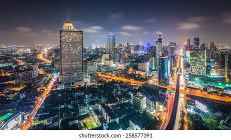 Aerial view of Bangkok skyline with urban skyscrapers at night