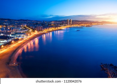 Aerial view of Barcelona Beach in summer night along seaside in Barcelona, Spain. Mediterranean Sea in Spain.