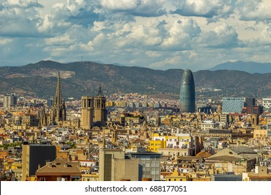 Aerial view of Barcelona city with Sagrada Familia and Agbar Tower in background, Spain.
