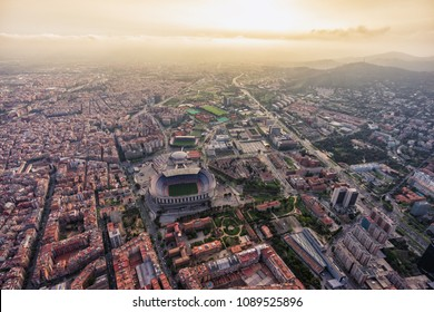 Aerial view of Barcelona city stadium at sunset, Spain. Direct front light