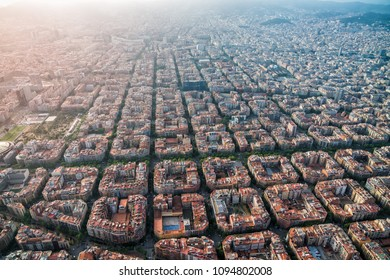 Aerial view of Barcelona cityscape with typical urban grid, Spain. Light leak effect applied