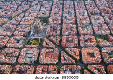 Aerial view of Barcelona Eixample residencial district and famous basilica, Spain. Late afternoon light