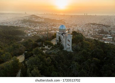 Aerial view to Barcelona with Fabra Observatory in the foreground at morning