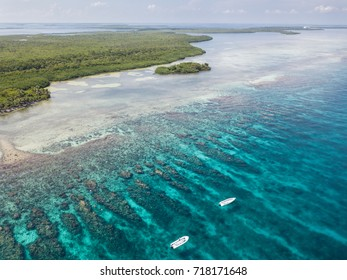 An aerial view of the barrier reef along Turneffe Atoll in Belize reveals spur and groove channels that exist near shore. This type of reef often develops on windward sides of islands.