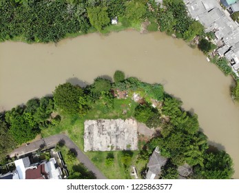 Aerial view of basket ball court near a brown color water river in Kemang Pratama Residence Bekasi Indonesia