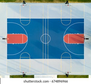 Aerial view of a basketball court with sunset soft light