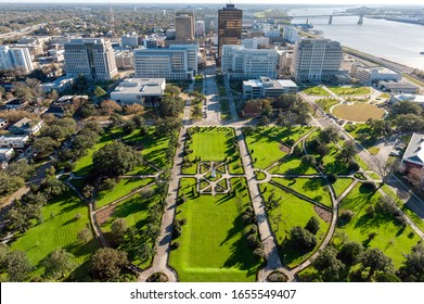 Aerial view of Baton Rouge, Louisiana, showing decorative gardens, the business district and the Mississippi river bridge.